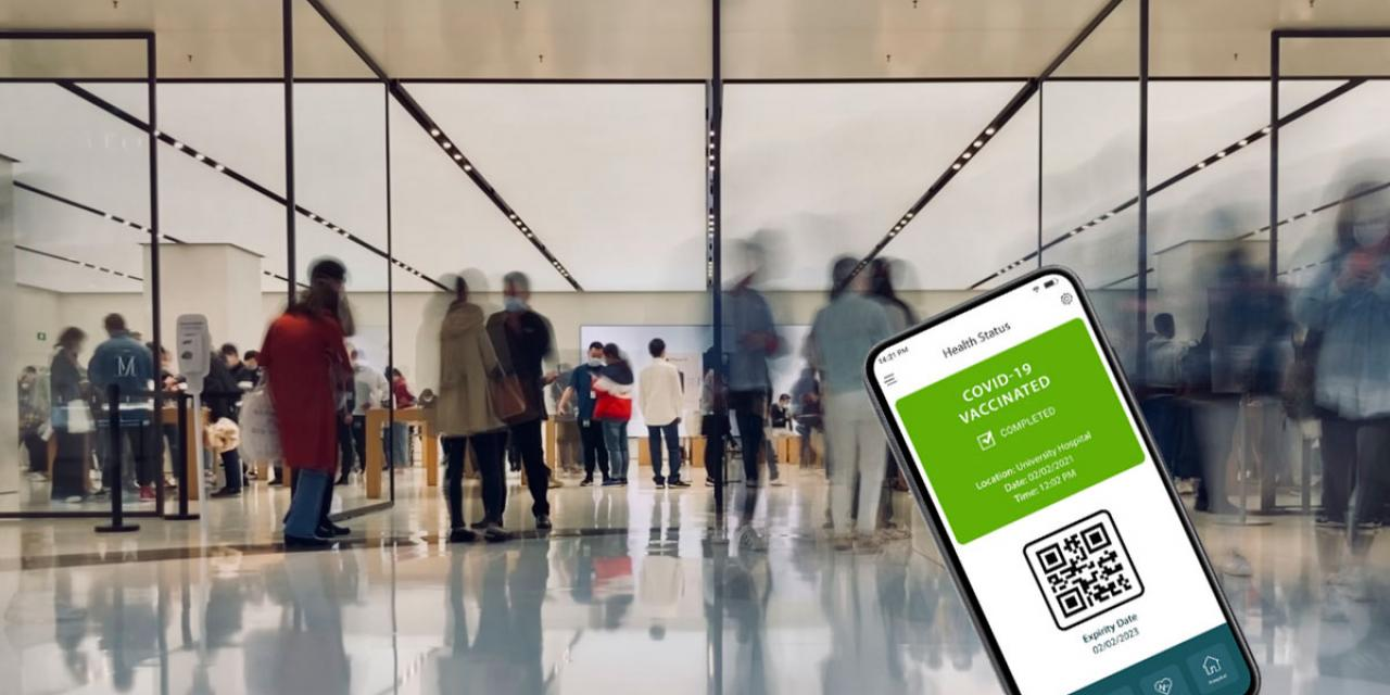 Smartphone showing a Green Certificate mock-up on display, blurry airport hall in background