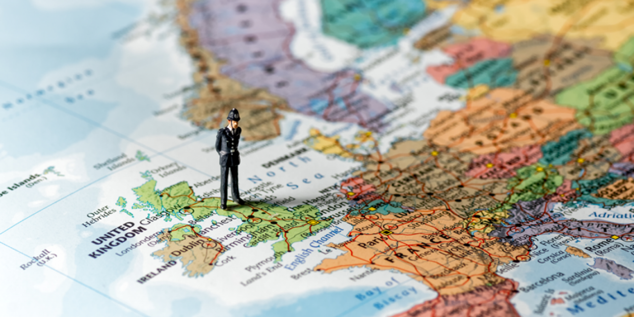 Figure of a British policeman on a map of Europe