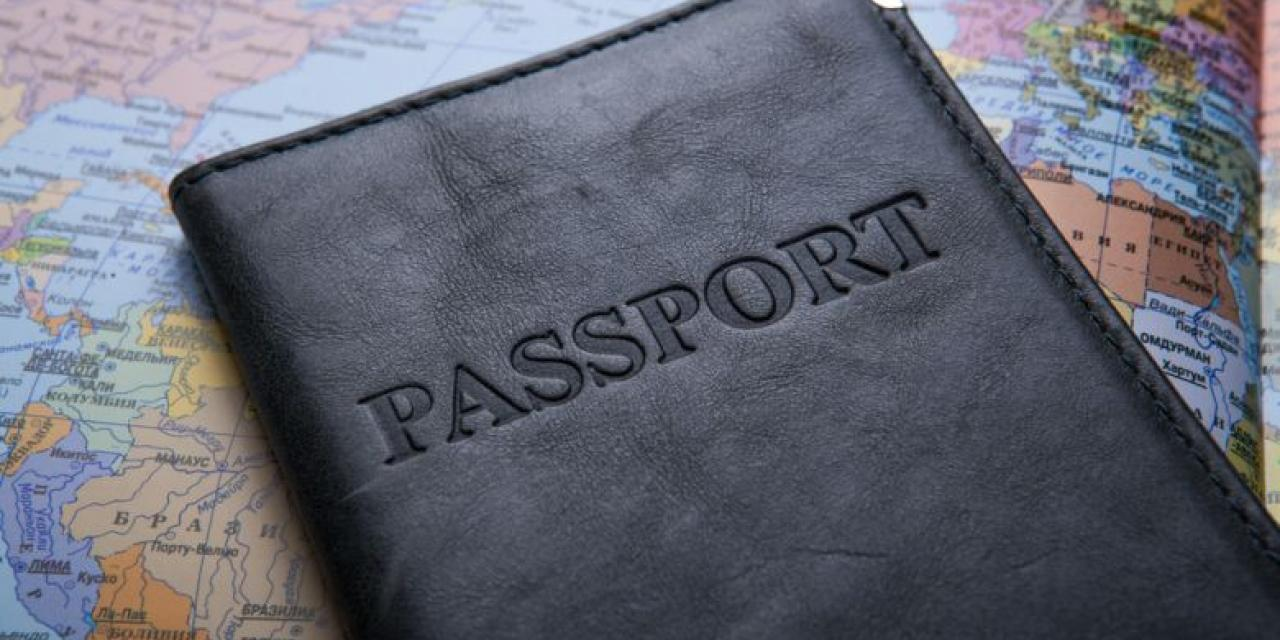 Passport in leather case on map