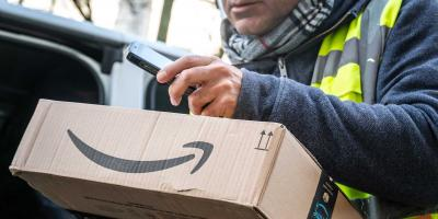 Parcel service delivery agent scans code of an Amazon parcel