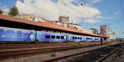 Blue painted Connecting Europe Express at a track in Lisbon.